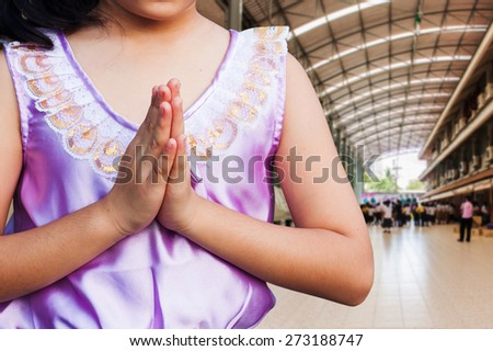 student wear uniform Thai  gesturing  in front of the school building . Welcome back to school - stock photo