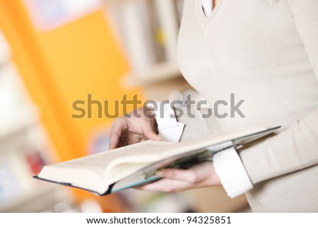 student with a book, hands close up - stock photo