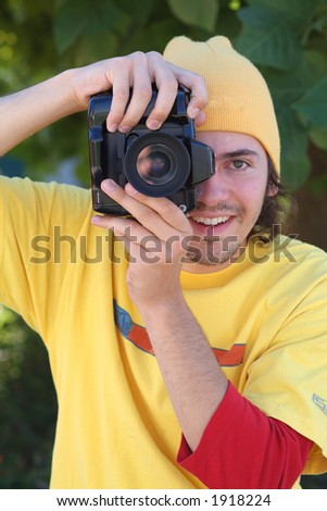 student with camera - stock photo