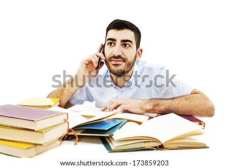 Student with Mobile Phones at the school desk. Isolated on the white background  - stock photo