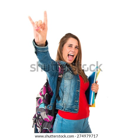 Student woman making horn gesture over white background - stock photo