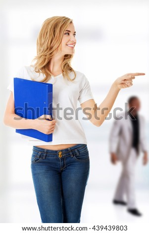 Student woman showing copyspace - stock photo