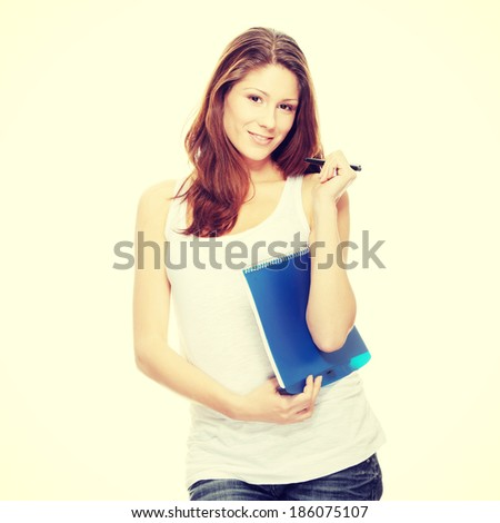 Student woman with note pad and pen  - stock photo