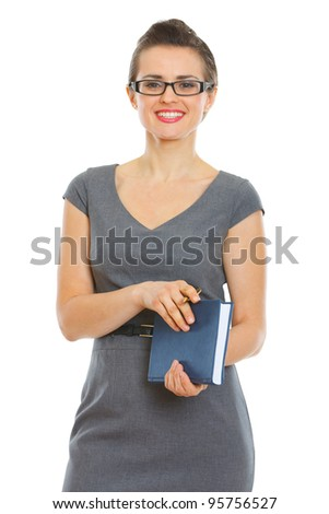 Student woman with notebook and pen - stock photo