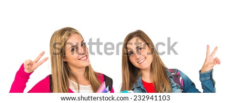 Student women doing victory gesture over white background - stock photo