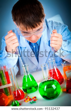 student working in the lab - stock photo