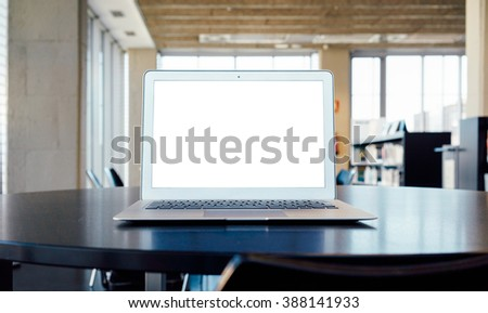 Student workplace with open laptop on a modern office background. blank screen for your design, text or content - stock photo