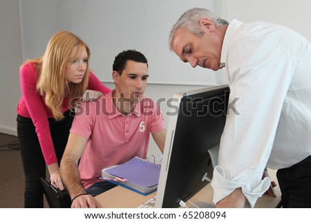 Students and professor in computer course - stock photo