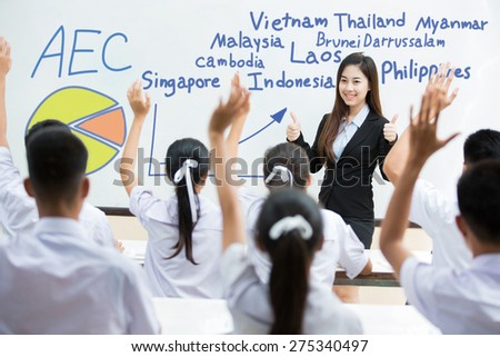 Students answer the teacher's questions in  Asean Economics Community(AEC) the classroom - stock photo