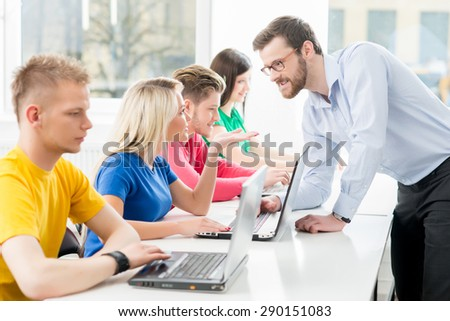 Students at the informatics and programming lesson  - stock photo