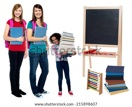 Students carrying textbooks and backpack - stock photo