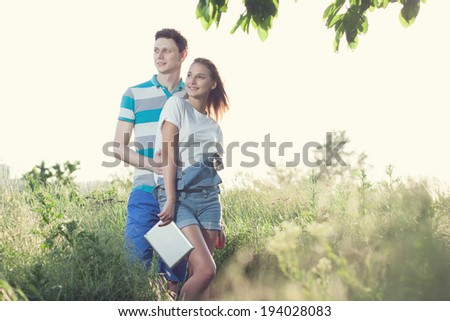 Students couple have meeting outdoors - stock photo