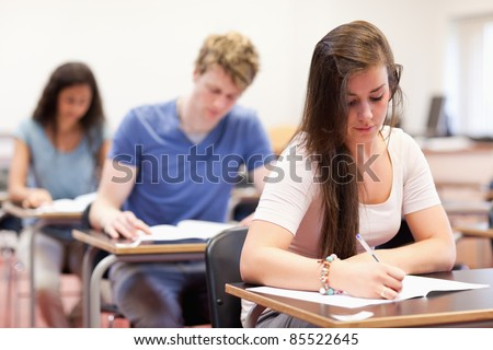 Students doing an assignment in a classroom - stock photo