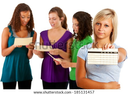 Students: Girl Disappointed in Grades on Report Card - stock photo