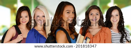 Students going to class at their college - stock photo
