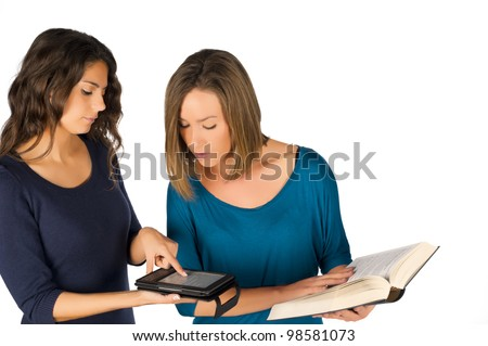 Students holding books, both paper and electronic - stock photo