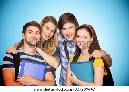 Students holding folders at college corridor against blue background with vignette - stock photo