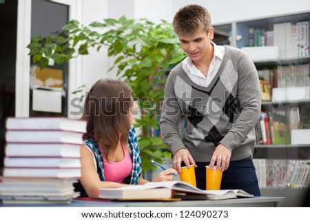 Students in a university library - stock photo