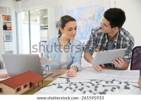 Students in architecture working on project - stock photo
