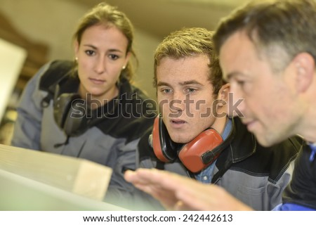 Students in carprentry listening carefully to trainer - stock photo