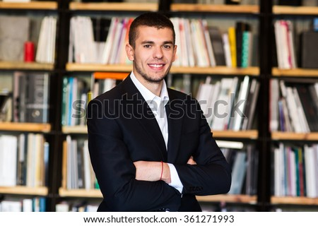 Students in the library in the background bookshelves - stock photo