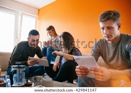 Students Learning In The Living Room - stock photo