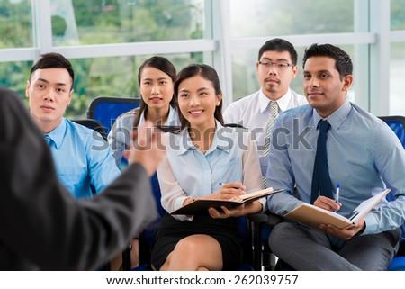 Students listening to teacher - stock photo
