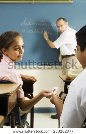 Students Passing Love Notes During Class - stock photo