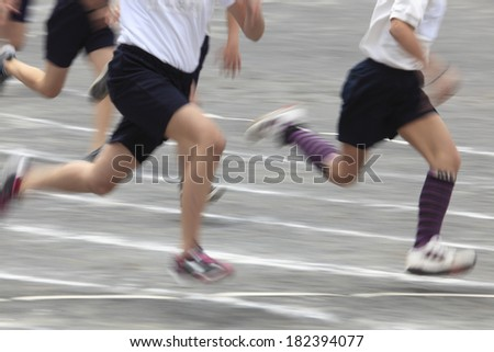 Students running during a field day - stock photo