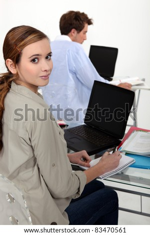 Students using laptop computers with blank screens - stock photo
