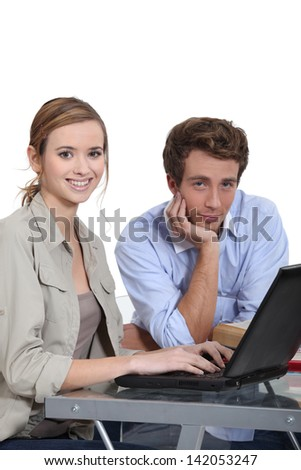 students working on a computer - stock photo