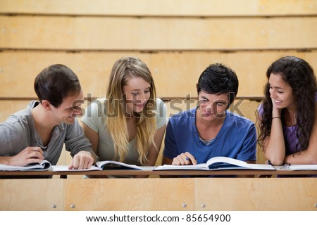 Students working together in an amphitheater - stock photo