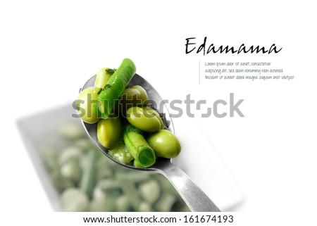 Studio close-up of spoon with edamame salad, comprising boiled green soy beans with a light dressing. A popular and healthy Japanese cuisine. Copy space. - stock photo