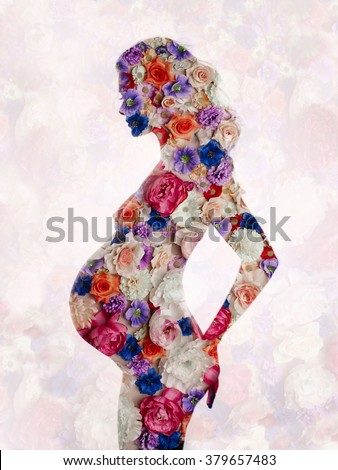 Studio conceptual art fashion photo of  perfect pregnant lady on floral background - stock photo