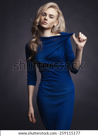 Studio fashion photo of elegant beautiful lady in blue dress - stock photo