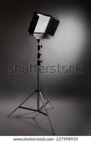 studio flash throwing a spotlight on the wall - stock photo