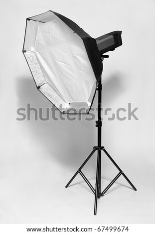 Studio flash with big octagonal soft-box isolated on a white background. - stock photo