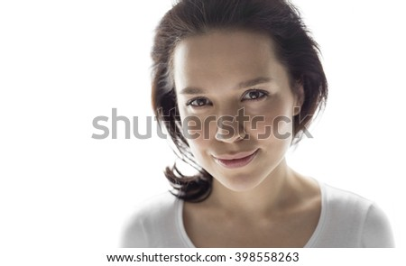 Studio headshot of young attractive woman smiling gently - stock photo
