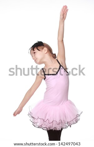 Studio image of a charming dancer with beautiful hair in a pink tutu smiling and dancing on white background - stock photo