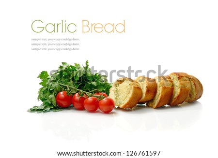 Studio macro of sliced crusty garlic and cheese Italian bread, parsley herbs and cherry tomatoes on a white background with soft shadows. Copy space. - stock photo