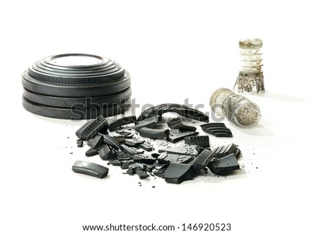 Studio macro of stacked clay pigeon targets a shattered clay and spent shotgun cartridges with soft shadows against a white background. Copy space. - stock photo