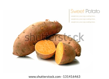 Studio macro of stacked sweet potatoes with soft shadows on a white surface. Copy space. - stock photo