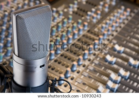 Studio microphone and mixing console - stock photo
