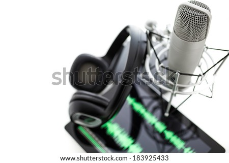 Studio microphone for recording podcasts with headset on a white background. - stock photo