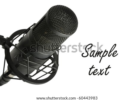 Studio microphone on white background with copy space - stock photo