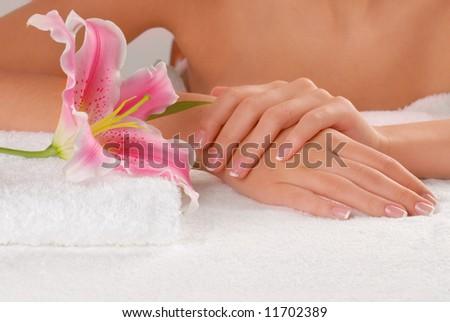 Studio nail - woman's hands on white towel - stock photo