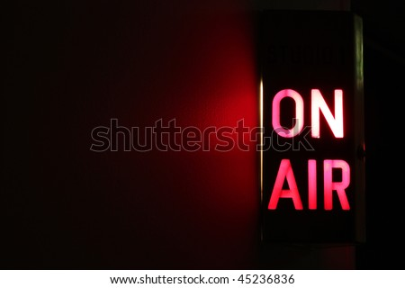 Studio On Air sign illuminated with glowing copy space - stock photo