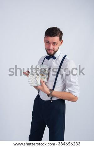 Studio photo businessman with money - stock photo