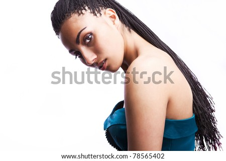 Studio photo of a beautiful mulatto girl in fashion dress on white background. - stock photo