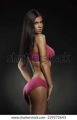 studio photo of posing sexy woman with nice lingerie on black background - stock photo